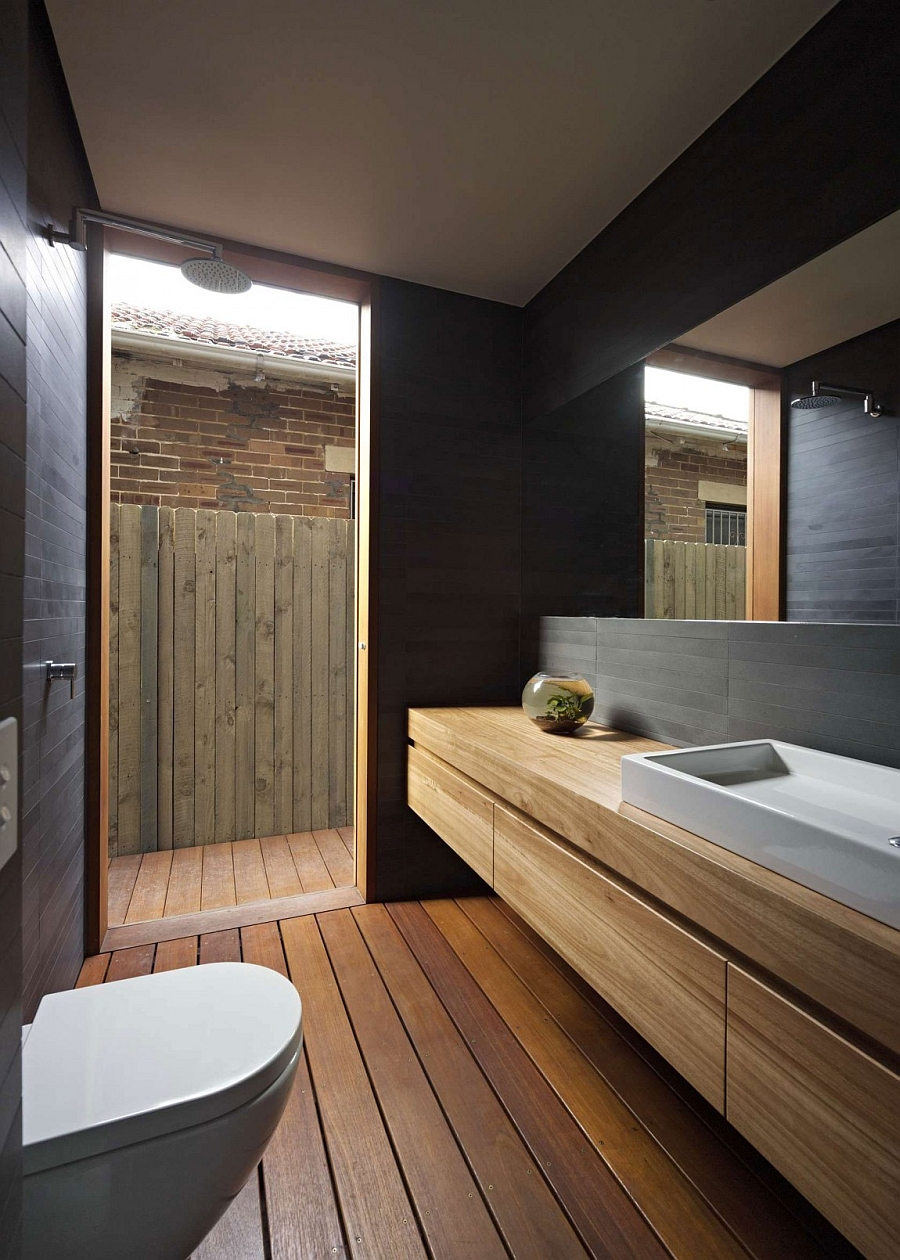 Small Exquisite Bath Creatively Making Use of Space and Adding Cozy and Warmth Through Wood