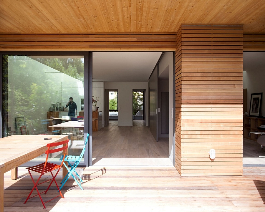 The Living Space is Extended Through Wooden Deck