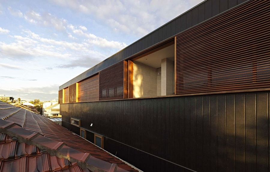Exterior Plywood House Combining Ample Ventilation With Private Quarters
