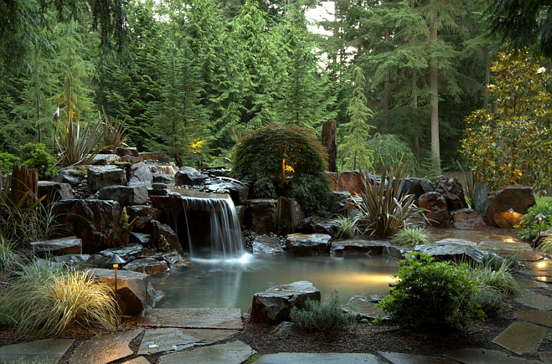 Basalt Rocks Along Japanese Maple and Dreamy Waterfall Shaping the Stunning Pool Retreat