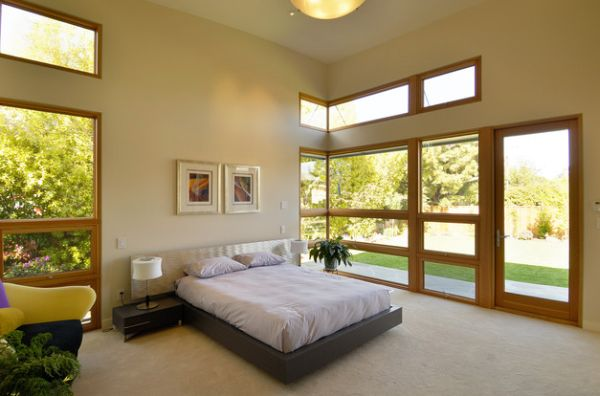 Wood and Expansive Views Enhancing a High Ceiling Master Bedroom with a Floating Bed