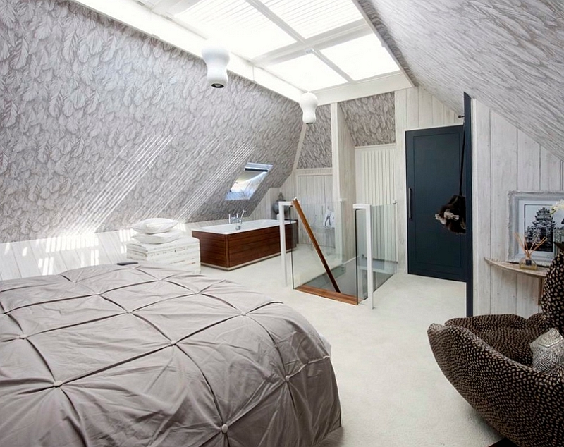 Unusual Loft Bedroom Featuring a Standalone Bathtub in the Corner
