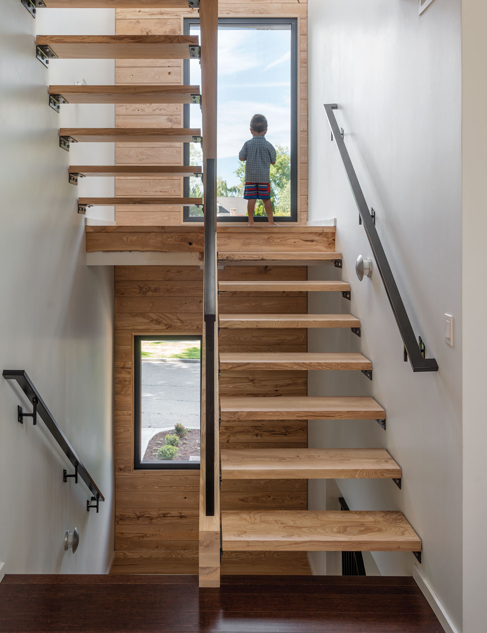 Airy Staircase Design Enhanced by Wood Through Coziness and Warmth