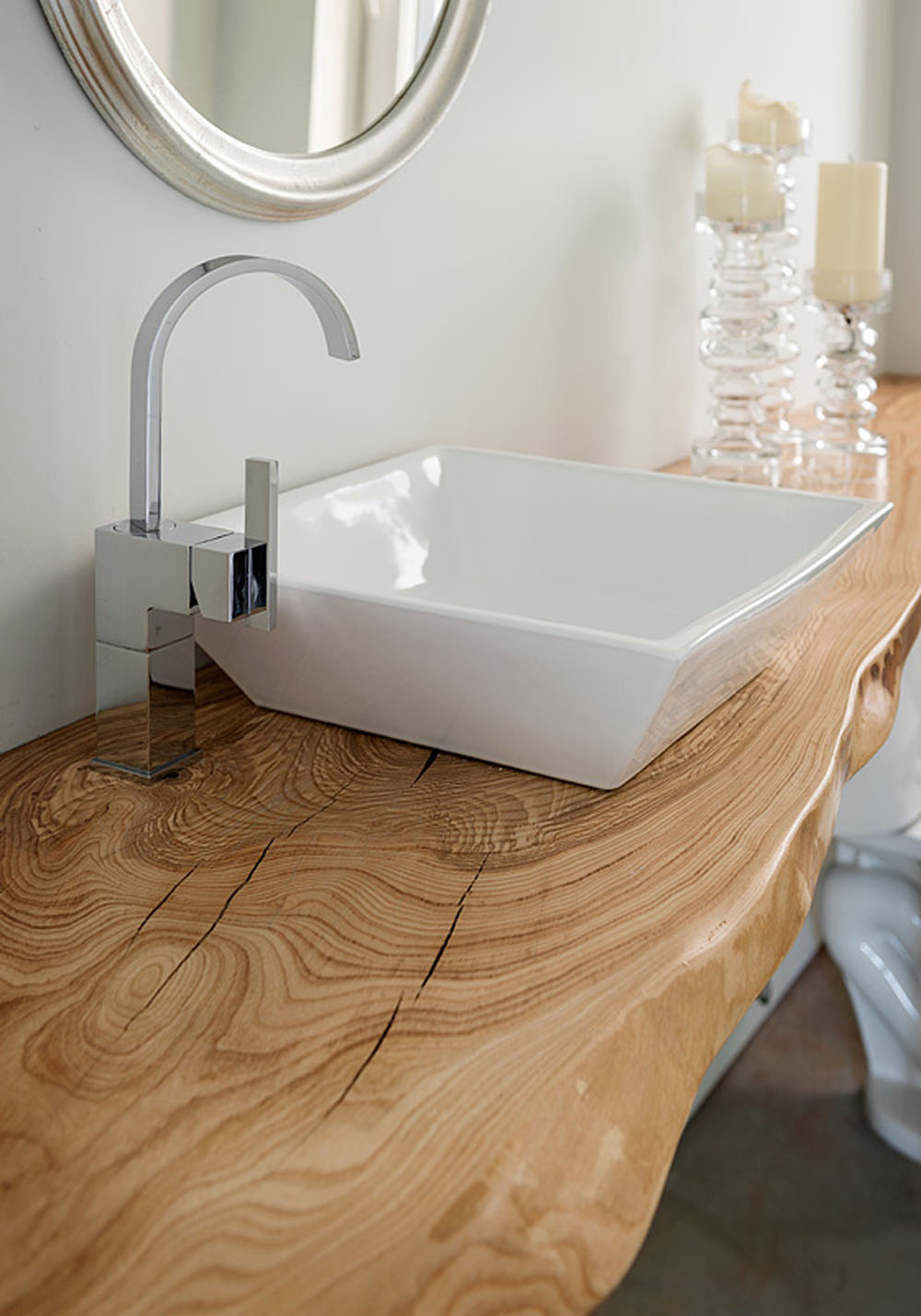 Sculptural Sink Placed on a Natural Wood Counter