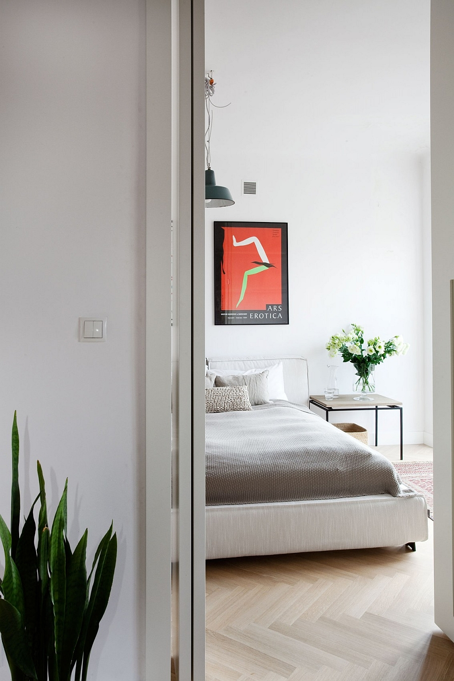 Cast a Glance on the Side Table and Natural Flowers Enhancing the Bedroom`s Serenity
