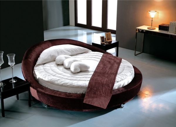 Modern chocolate velvet round bed.