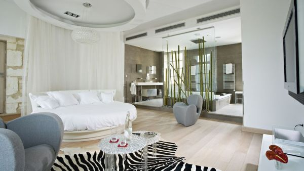 white round bed positioned in the center of this interior