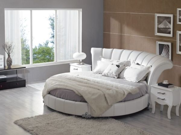 Pastel bedroom with white leather round bed.