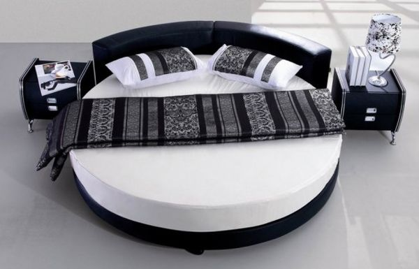 Black and white minimalist round bed.