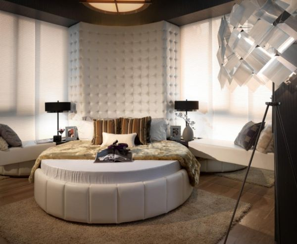 Multi-textured round bed bedroom.