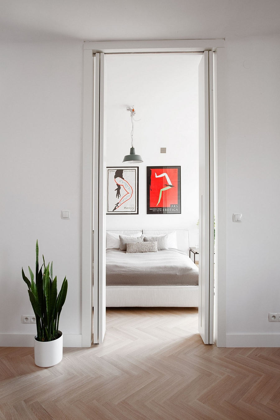 70s-80s Vintage Posters Adding Color to The Contemporary Bedroom