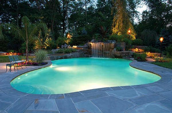 Waterfall Cascade Over Stone Into an Organic Shaped Swimming Pool