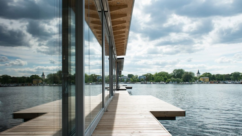 simple wooden deck at the Boat-Homes-in-Berlin-Boasting-a-Comfortable-and-Colorful-Unique-Experience