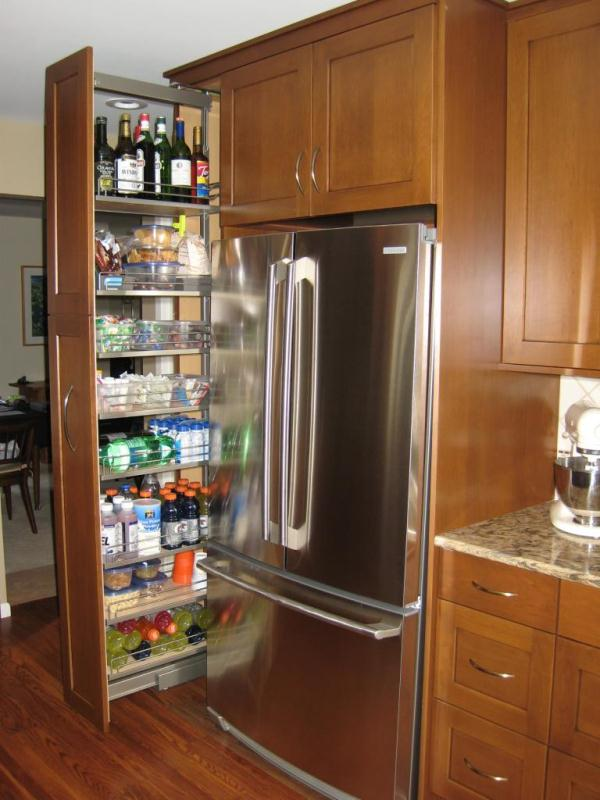 Kitchen Storage Ideas That Will Enhance Your Space-Pull-Out Pantry Cabinet homesthetics (2)