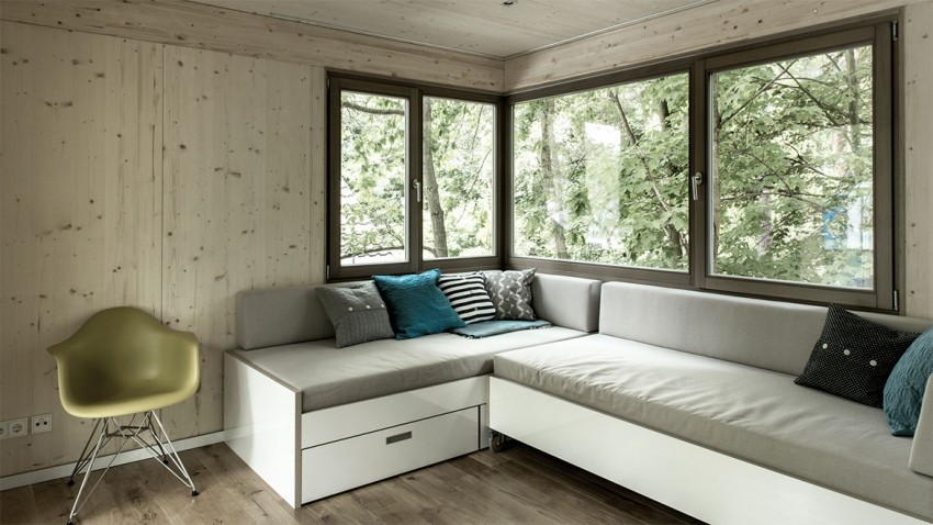 space efficient corner sofa in the Superb Urban Treehouse Surrounded by Forest in Berlin Germany