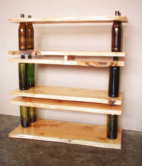 Simple solution for shelves can be realized by teaming up empty bottles and wood boards