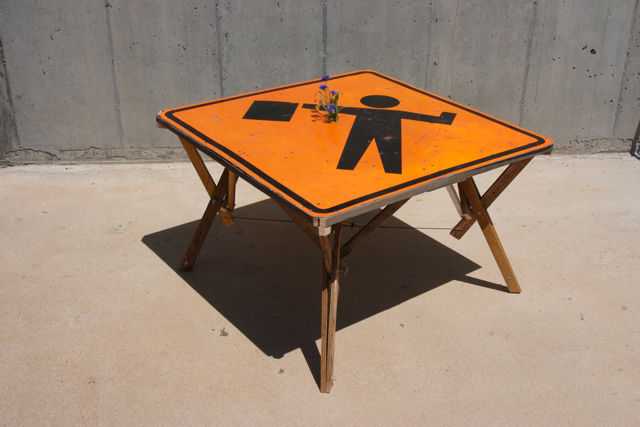 Using a road sign for a table can be a statement, but also an interesting piece of furniture that will brighten up your room. You can use a customized sign for effect .