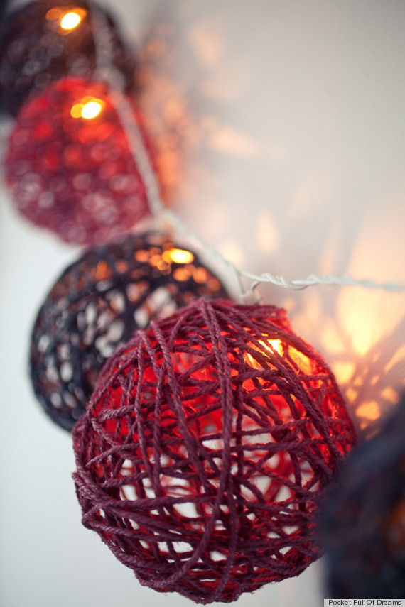 1. Glued colored rope balls turned into holiday shimmering light installation