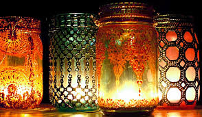 14. Paint mason jars and place candles inside for a mysterious light play