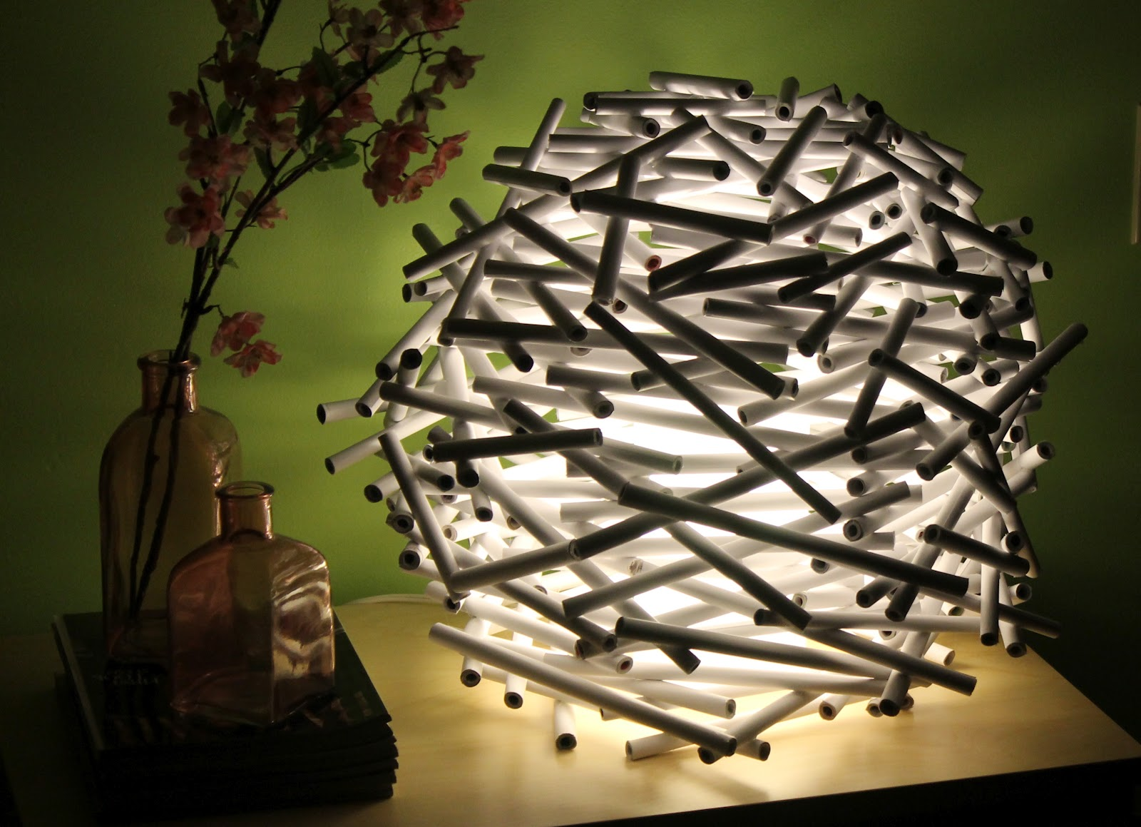 15. Glue PVC sticks in a round shape and add some light for an interesting effect