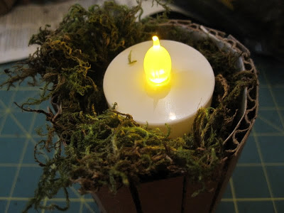 16. Use old cardboard to make an easy DIY candle holder