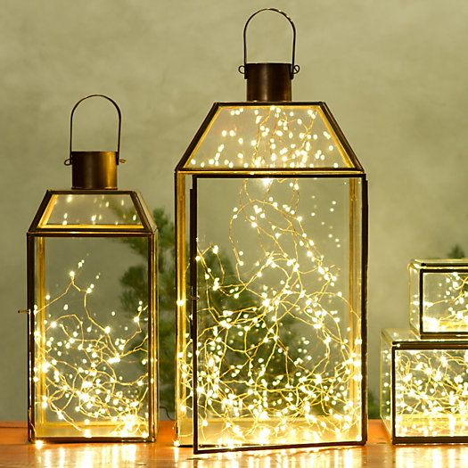 17. Reuse old glass lanterns and add a shimmering light installation