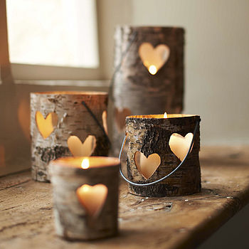 18. Use tree bark as beautiful candle holders