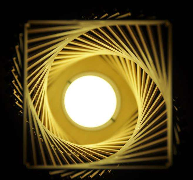 10. Origami lamp made out of bamboo sticks