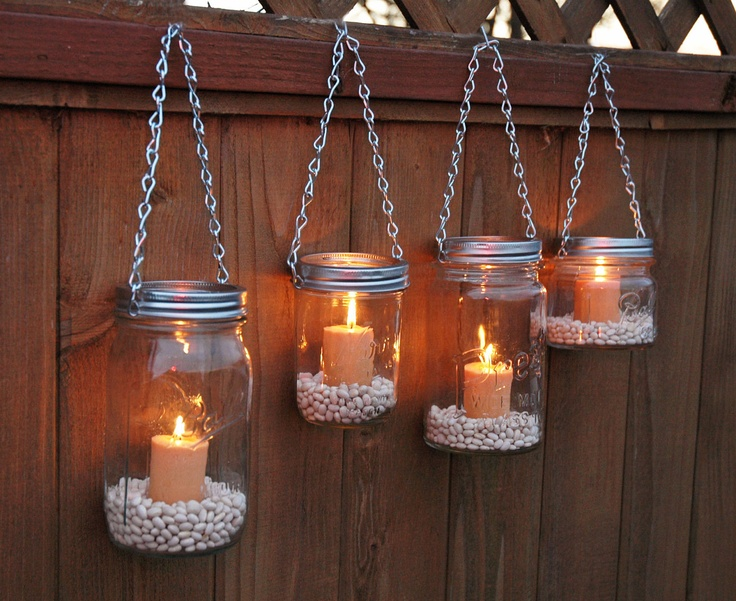 13. Hang mason jars in your backyard and light candles in them for a romantic atmosphere
