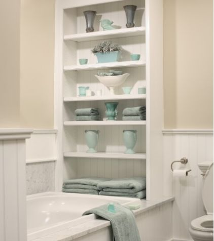 vertical shelf at the end of the bathtub in stark white