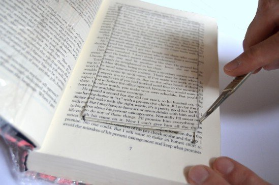 Create a Hidden Spot in the Library by Sticking All The Pages of a Book and Cropping the Middle