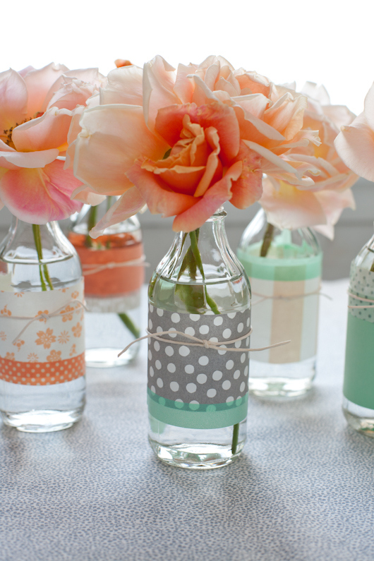 13. REVIVE OLD BOTTLES WITH COLORFUL PAPER AND USE THEM AS FLOWER VASES