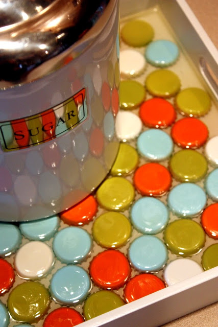 beautiful colorful serving tray realized with bottle caps