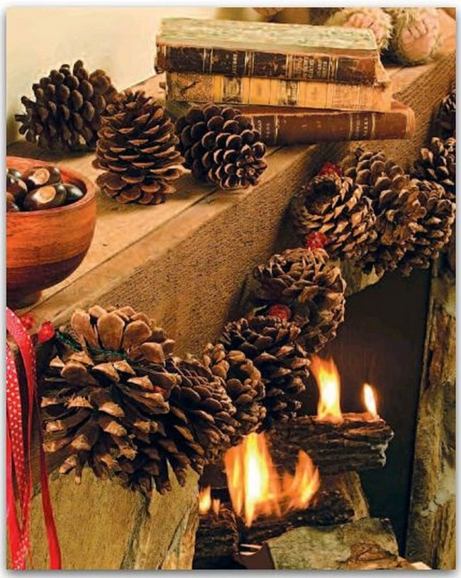 Pinecone Garland Enhancing a Spectacular Fireplace