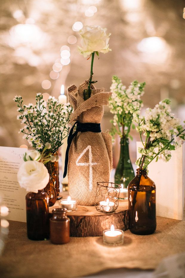 31 beautiful wine bottles centerpieces perfect for any table for Wine centerpiece ideas