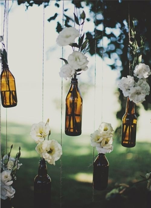 suspended glass bottle installation doubling as a wall divider