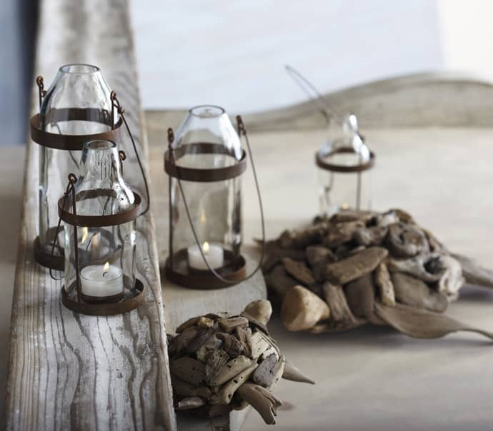 glass votive candles in metal salvaged lanterns