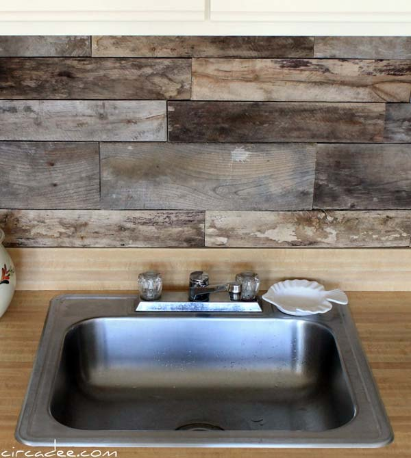 1. Old wooden pallets used in a kitchen backsplash