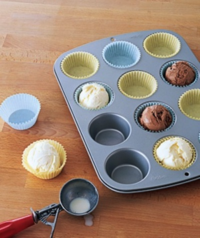 52. PART ICE CREAM SCOOPS SERVED PERFECTLY IN MUFFIN PANS FILLED WITH LINERS