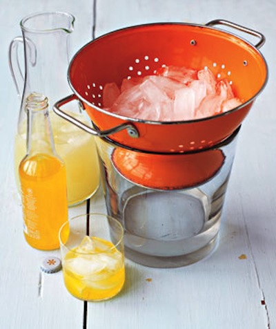 23. USE A COLANDER AS AN ICE BUCKET FOR YOUR PARTIES