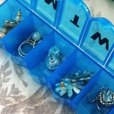 45. ORGANIZE YOUR EARRINGS IN A PILL BOX