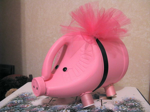 #10 PINK SCULPTURAL CLOROX BOTTLE PIGGY BANK