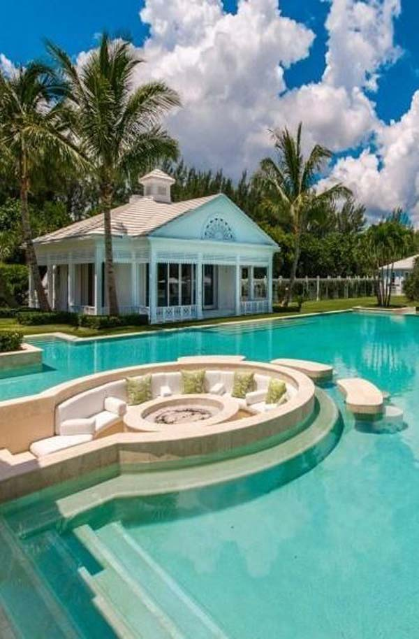21 Glamorous and Spectacular Lounge Areas and Bedrooms Nestled Between Pools homesthetics decor surrounded by a pool (21)