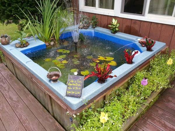 21 small garden backyard aquariums ideas that will for Homemade koi pond