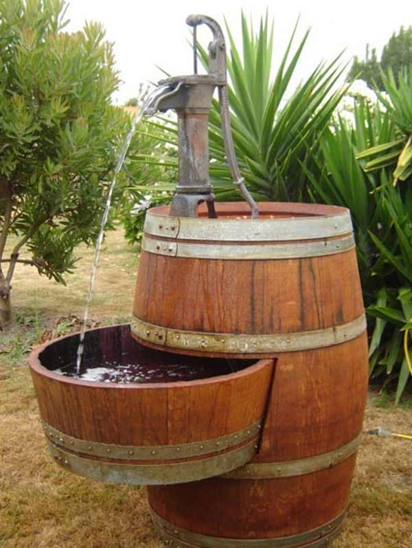 25 brilliantly creative diy projects reusing old wine barrels for Decoration jardin tonneau
