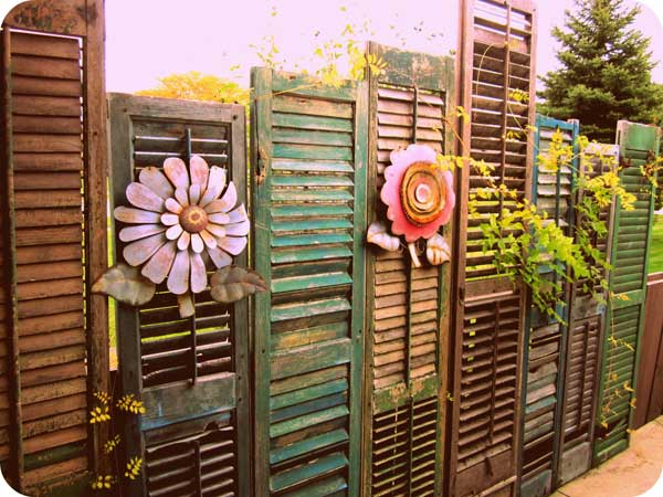 21.OLD SHUTTERS REUSED IN A VINTAGE FENCE