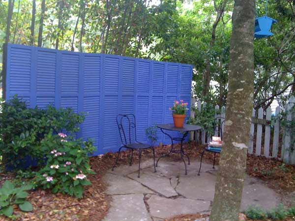 8.PAINT AND REUSE SHUTTERS AS PRIVACY SCREENS AND FENCES