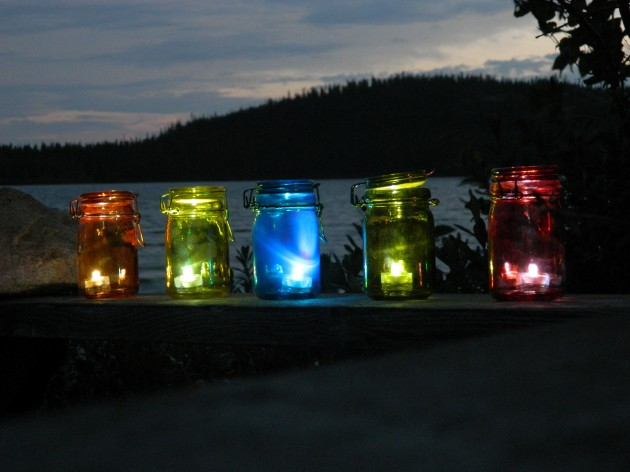 16 diy magical outdoor lighting solutions 4 neat mason jars lighten through string lights 16 diy magical outdoor aloadofball Image collections