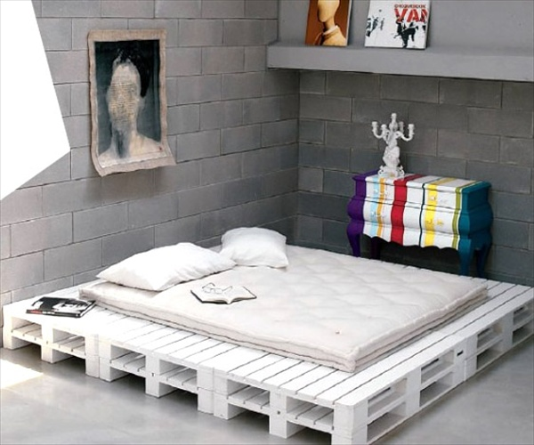 #18 BRICK WALL AND ECLECTIC PIECES BY A SIMPLE WHITE PALLET BED