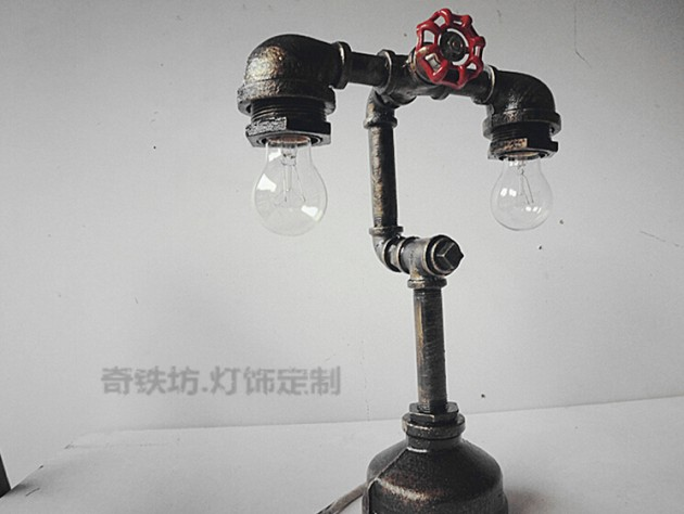 #15 RED WATER TAP ACTIVATING THE LAMP AND POSITIONING IIT IN ITS INDUSTRIAL BACKGROUND